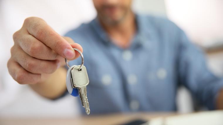 Man Holding Keys